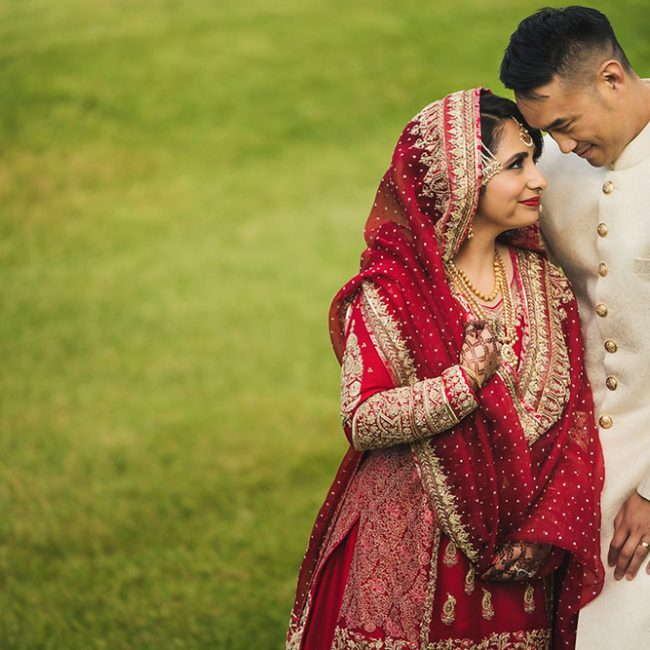 Pakistani bride in red gharara and Chinese groom in white sherwani - Arora Events, Toronto's best wedding and event planners!