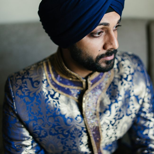 Sikh groom in blue brocade sherwani and blue turban - Arora Events, Toronto's best wedding and event planners!