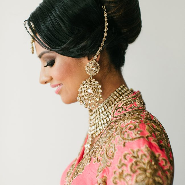 Indian bride in profile in pink lehenga - Arora Events, Toronto's best wedding and event planners!