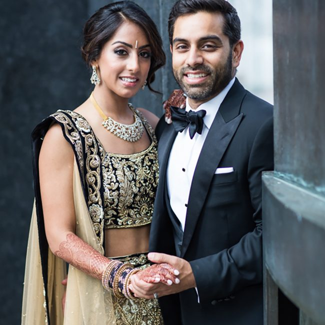 Indian bride in taupe and black lehenga and Indian groom in black tuxedo - Arora Events, Toronto's best wedding and event planners!