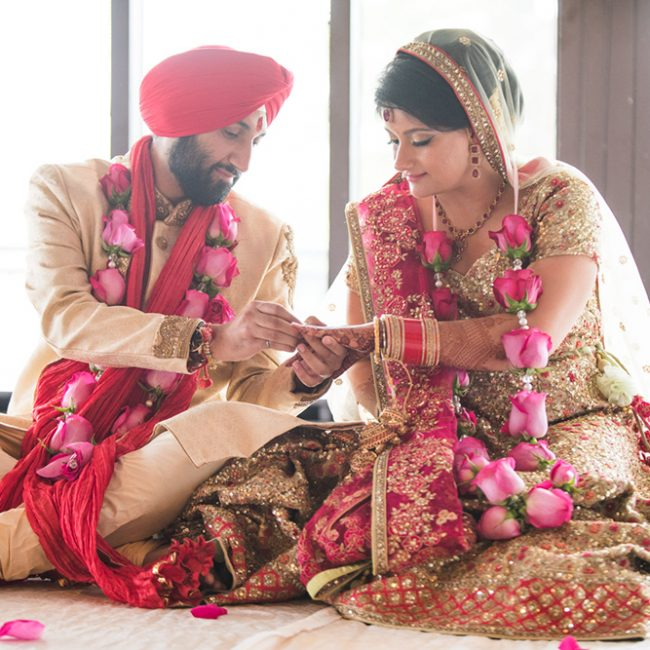 Interfaith couple in a fusion wedding ceremony - Sikh groom in red turban - Arora Events, Toronto's best wedding and event planners!