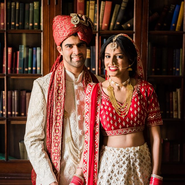 Indian bride and groom in red and white - Arora Events, Toronto's best wedding and event planners!