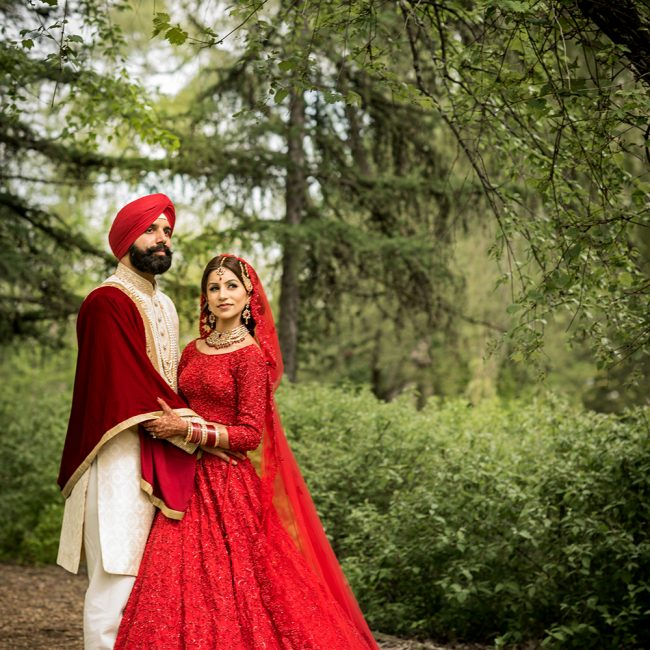 Sikh bride in red lehenga with Sikh groom - Arora Events, Toronto's best wedding and event planners!
